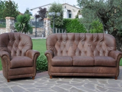 Orr-Sofa-and-Armchair-in-Leather-with-stud-detai-at-Kicroney-Furniturel