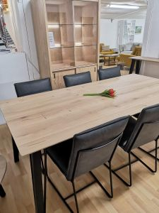 Light oak table and dark grey chairs