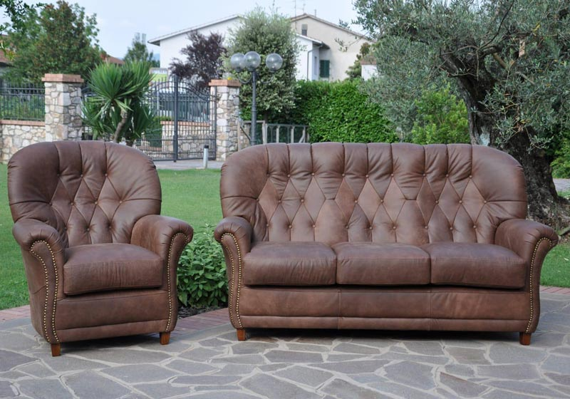 Orr-Sofa-and-Armchair-in-Leather-with-stud-detai-at-Kilcroney-Furniturel